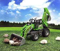 Wielki traktor z łyżką i koparką